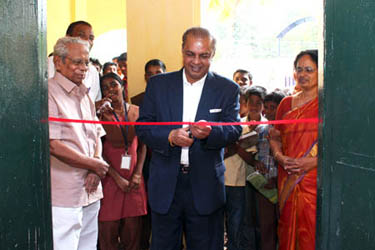 Dr Majeed cutting the ribbon – Inagurating the Advanced Lab facility at the craven School. On the left stands the Ex Headmaster S Jacob and on the right Headmistress K Pavizhakumari